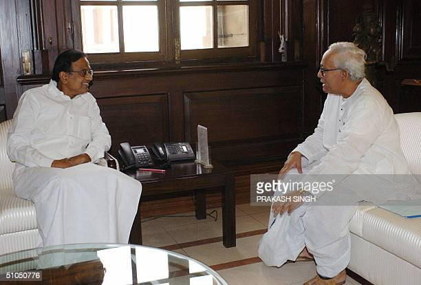 Chief Minister of the Indian State of West Bengal Buddha Dev Bhattacharya speaks with Indian Finance Minister P Chidambaram during a meeting in New...