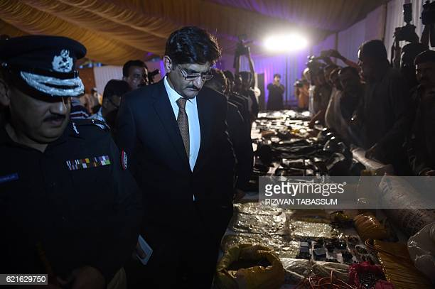 Chief minister of the southern Sindh province Pakistan Syed Murad Ali Shah and police officials look at recovered weapons from arrested militants...
