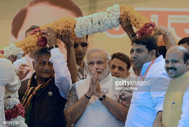 Chief Minister of the western Indian state of Gujarat and Bharatiya Janata Party prime ministerial candidate Narendra Modi is garlanded by his...