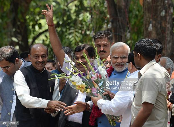 Chief Minister of the western Indian state of Gujarat and Bharatiya Janata Party primeministerial candidate Narendra Modi receives flowers from a...
