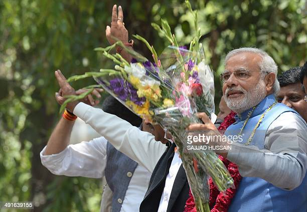 Chief Minister of the western Indian state of Gujarat and Bharatiya Janata Party primeministerial candidate Narendra Modi waves as he arrives at...