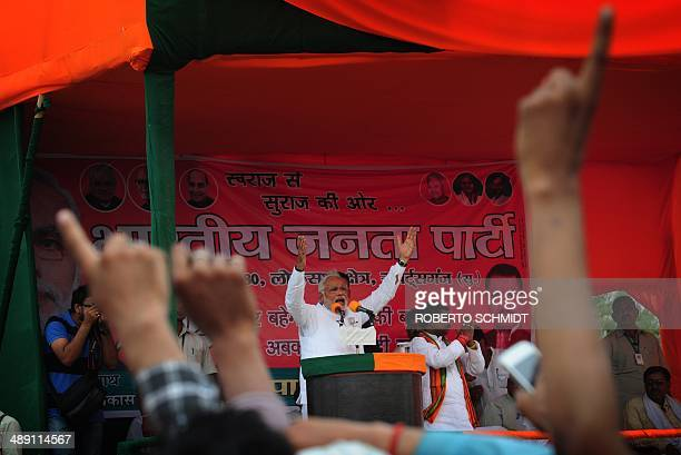 Chief Minister of the western Indian state of Gujarat and main opposition Bharatiya Janata Party prime ministerial candidate Narendra Modi gestures...
