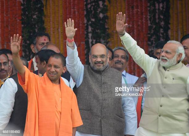 Chief Minister of Uttar Pradesh state Yogi Adityanath Indian Prime Minister Narendra Modi and Bharatiya Janata Party president Amit Shah attend...