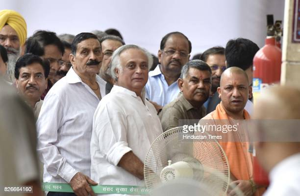 Chief Minister of Uttar Pradesh Yogi Adityanath Congress leader Jairam Ramesh and other leaders in queue for casting their votes for Vice...