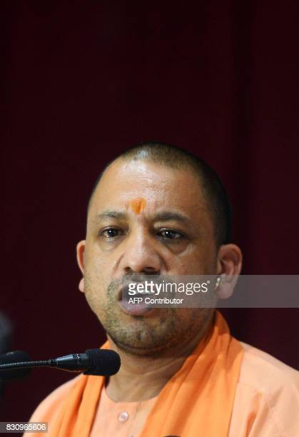 Chief Minister of Uttar Pradesh Yogi Adityanath speaks during a press confrence after visiting the Baba Raghav Das Hospital in Gorakhpur in the...