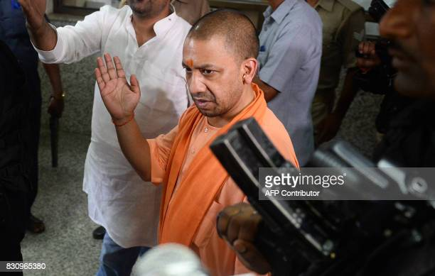 Chief Minister of Uttar Pradesh Yogi Adityanath walks out after visit the Baba Raghav Das Hospital in Gorakhpur in the northern Indian state of Uttar...