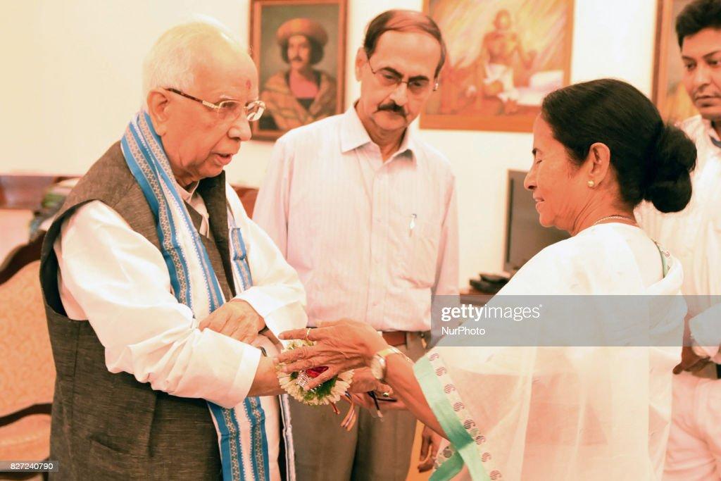 Chief Minister of West Bengal Mamata Banerjee tying to Rakhi West Bengal Governor Kesori Nath Tripathi on Raksha Bandhan at Governor House on August 07,2017 in Kolkata