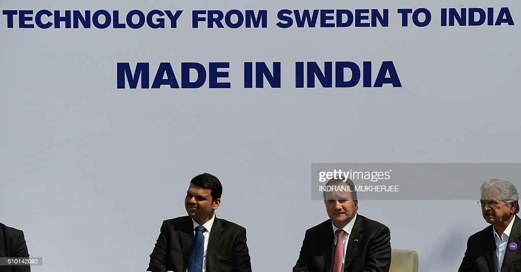 Chief Minister of western Indian Maharashtra state Devendra Fadnavis (L) and Prime Minister of Sweden Stefan Lofven (C), alongwith state industry minister Subhash Desai, attend the introduction of the first Volvo hybrid city bus made in India on the sidelines of the 'Make in India Week' in Mumbai on February 14, 2016. Over 190 companies, and 5,000 delegates from 60 countries, are taking part in the first 'Make in India' week to be held in Mumbai from February 13-18. AFP PHOTO/ INDRANIL MUKHERJEE / AFP / INDRANIL MUKHERJEE