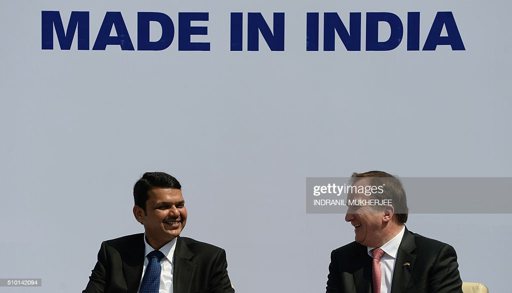 Chief Minister of western Indian Maharashtra state Devendra Fadnavis (L) and Prime Minister of Sweden Stefan Lofven smile during the introduction of the first Volvo hybrid city bus made in India on the sidelines of the 'Make in India Week' in Mumbai on February 14, 2016. Over 190 companies, and 5,000 delegates from 60 countries, are taking part in the first 'Make in India' week held in Mumbai from February 13-18. AFP PHOTO/ INDRANIL MUKHERJEE / AFP / INDRANIL MUKHERJEE
