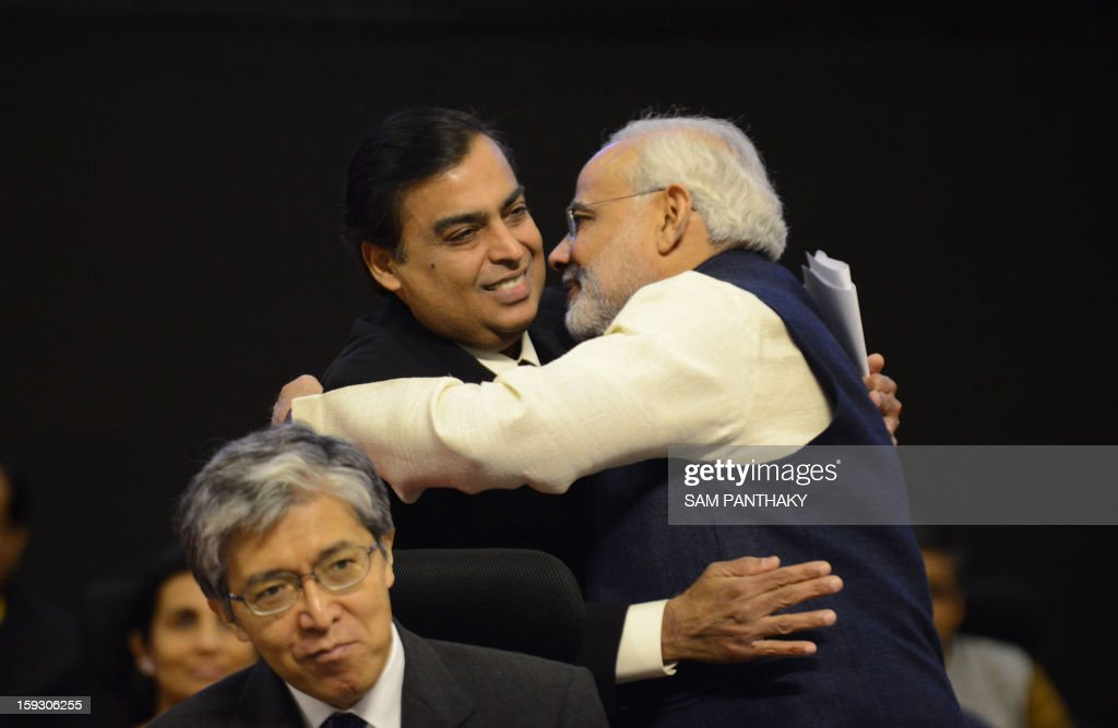Chief Minister of Western India's Gujarat state, Narendra Modi (R) greets Chairman and Managing Director, Reliance Industries Ltd. Mukesh Ambani on the launch of Vibrant Gujarat 2013 6th Global Summit at Mahatma Mandir in Gandhinagar, some 30 kms from Ahmedabad on January 11, 2013. The summit is being attended by national and international corporates in large numbers. AFP PHOTO / Sam PANTHAKY