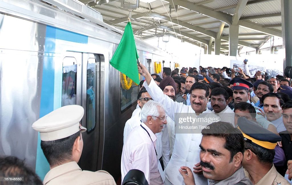 Chief Minister Prithviraj Chauhan flags off metro rail at its first successful run at Versova, Andheri West on May 1, 2013 in Mumbai, India. Maharashtra's first Metro from Versova to Airport Road in Mumbai will be commissioned in September.