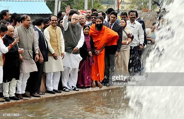Chief Minister Shivraj Singh Chouhan along with senior BJP leaders Lal Krishna Advani Nitin Gadkari Sushma Swaraj and Yoga Guru Baba Ramdev during...