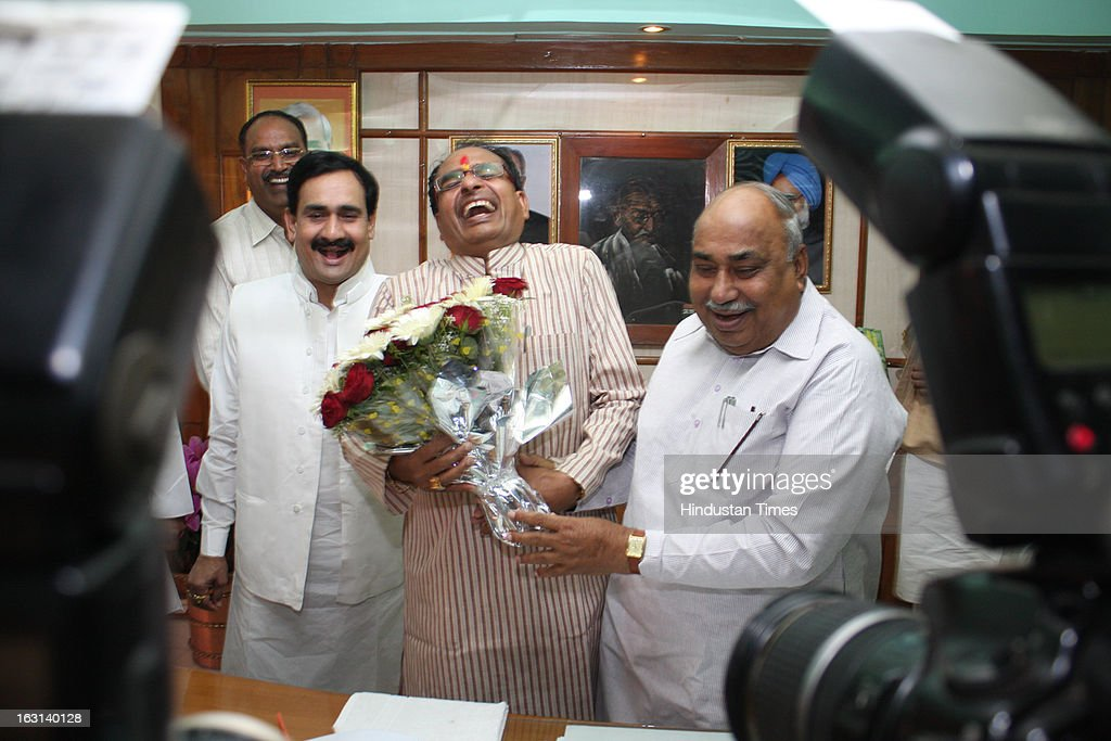 Chief minister Shivraj Singh Chouhan bursts into laughter on as he receives birthday greetings from Madhya Pradesh state assembly speaker Ishvardas Rohani on his 54th birthday on March 5, 2013 in Bhopal, India.