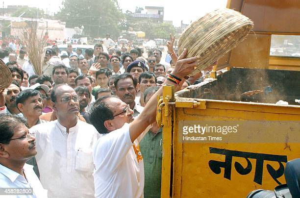 Chief Minister Shivraj Singh Chouhan collecting garbage as part of the Swachh Bharat Abhiyan at Chhola Dussehra ground on October 2 2014 in Bhopal...
