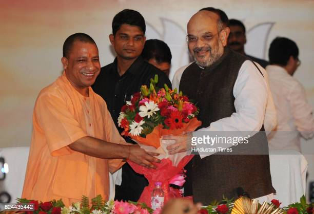Chief Minister Yogi Adityanath welcomes BJP President Amit Shah by giving bouquet at Indira Gandhi Pratishan on July 29 2017 in Lucknow India Shah...