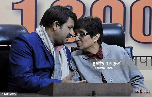 Chief Ministerial candidate for Delhi Kiran Bedi with Party MP from East Delhi Manoj Tiwari at a press conference addressed by Finance Minister and...