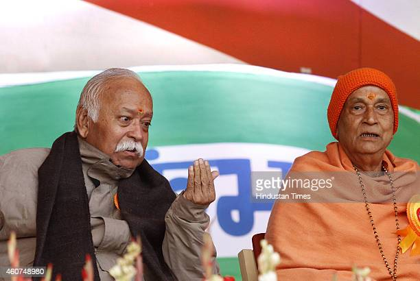 Chief Mohan Bhagwat with Swami Satya Mitra Nand ji Maharaj during Vanvasi Raksha Parivar Kumbh at Japanese park Rohini on December 21 2014 in New...