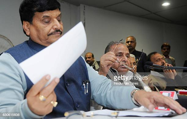 Chief Mulayam Singh Yadav addressing media along with Shivpal Yadav during a press conference on December 28 2016 in Lucknow India Ruling out any...