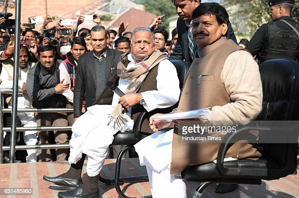 Chief Mulayam Singh Yadav and his brother and party leader Shivpal Yadav at Samajwadi Party office on January 11 2017 in Lucknow India As he headed...