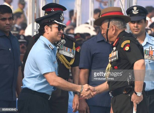 Chief of Army staff Bipin Rawat greets Sachin Tendulkar on the 85th anniversary of Indian Air Force at Hindon Air Base on October 8 2017 in Ghaziabad...