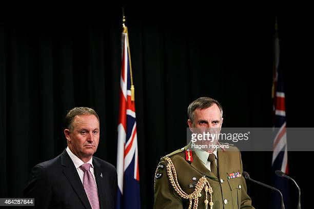Chief of Defence Force Lieutenant General Tim Keating and Prime Minister John Key speak to the media during a press conference at The Beehive on...