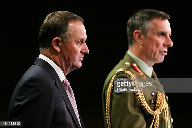 Chief of Defence Force Lieutenant General Tim Keating speaks to the media while Prime Minister John Key looks on during a media conference at The...