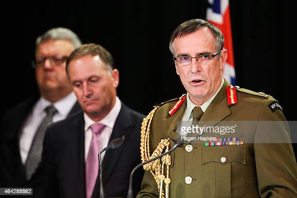 Chief of Defence Force Lieutenant General Tim Keating speaks to the media while Prime Minister John Key and Defence Minister Gerry Brownlee look on...