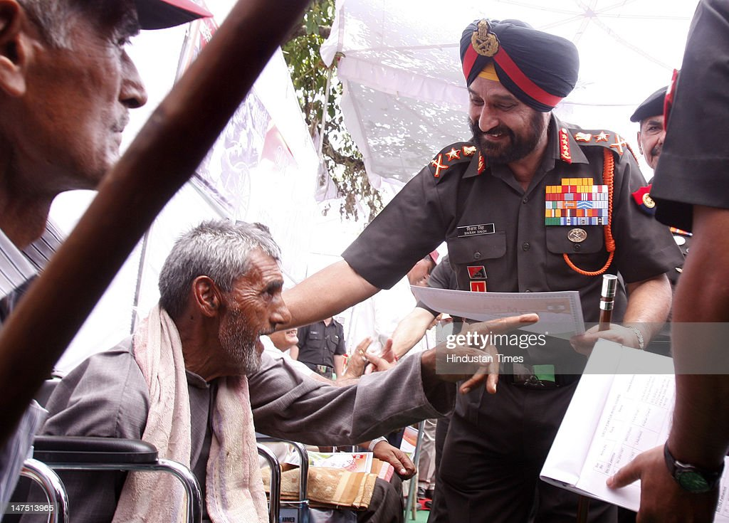 Chief of Indian Army staff General Bikram Singh meeting to former army men during their honor on the occasion of Ex-serviceman rally at Pathankot on July 1, 2012 in Punjab, India. Bikram Singh said the issue of one-rank-one-pension is being looked at the ministerial level and the ex-servicemen and war widows as his top priority.