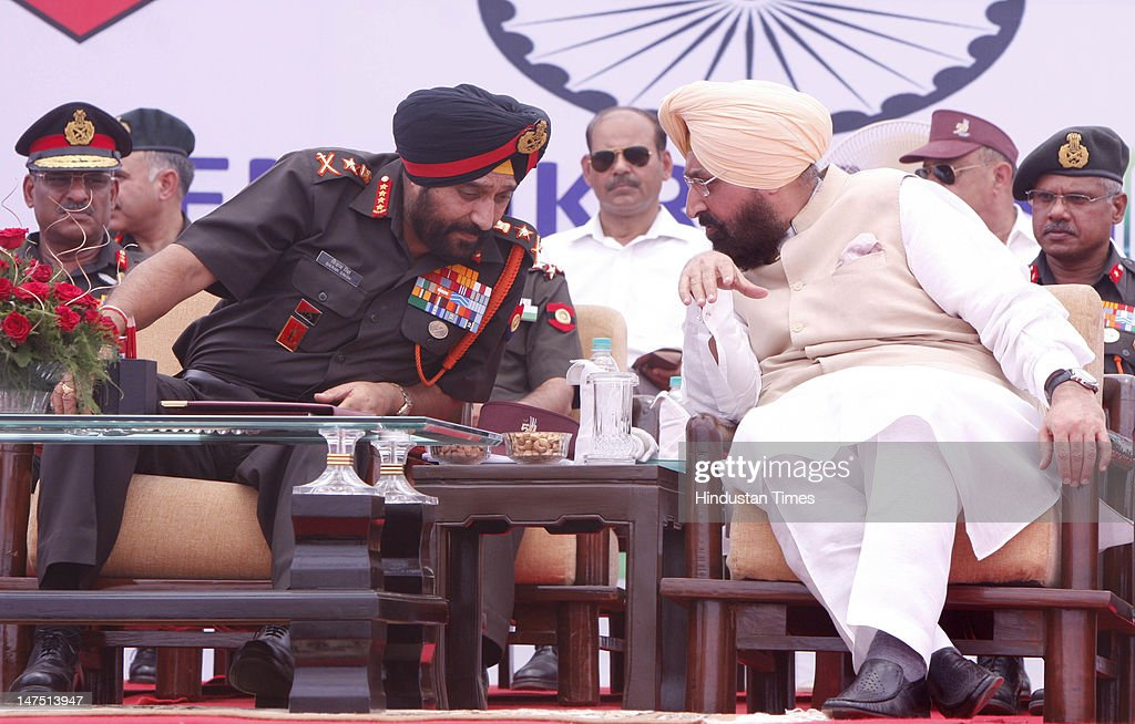 Chief of Indian Army staff General Bikram Singh (L) talking with MP Gurdaspur Pratap Singh Bajwa (R) during Ex-serviceman rally on the eve of 50-years Golden Jubilee celebration of 21 Sub Area at Pathankot on July 1, 2012 in Punjab, India. Bikram Singh said the issue of one-rank-one-pension is being looked at the ministerial level and the ex-servicemen and war widows as his top priority.
