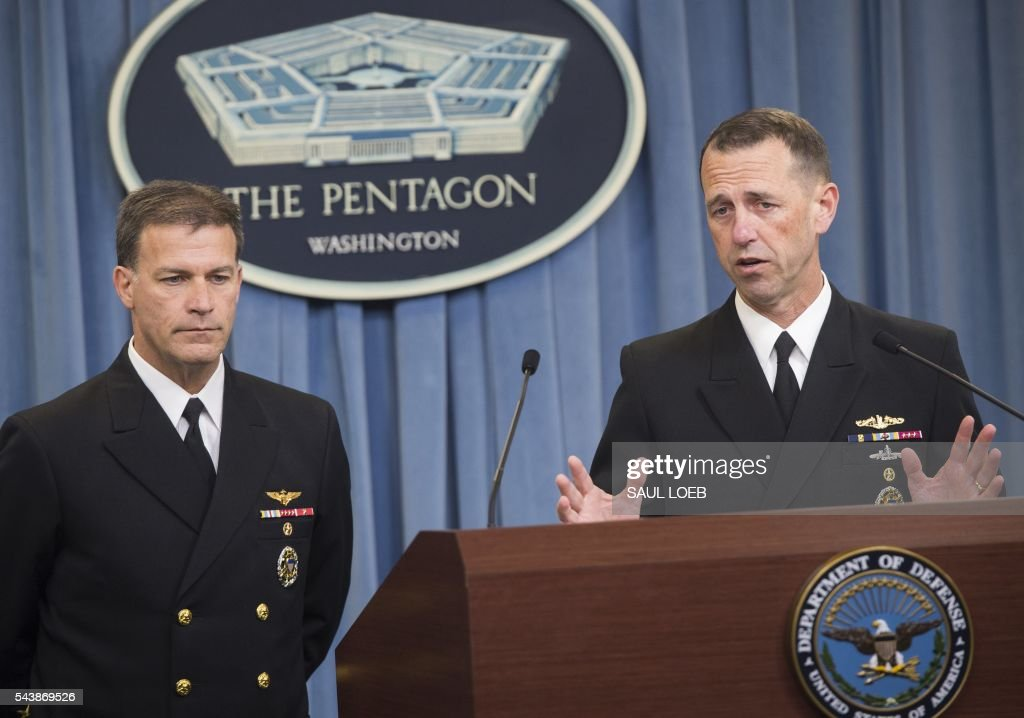 US Chief of Naval Operations Admiral John Richardson (R) and Deputy Chief of Naval Operations Vice Admiral John Aquilino, speak about the results of an investigation into a January incident where Iranian forces detained 10 US Navy personnel, during a press briefing at the Pentagon in Washington, DC, June 30, 2016. / AFP / SAUL