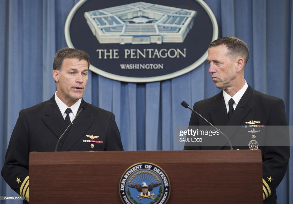 US Chief of Naval Operations Admiral John Richardson (R) and Deputy Chief of Naval Operations Vice Admiral John Aquilino (L), speak about the results of an investigation into a January incident where Iranian forces detained 10 US Navy personnel, during a press briefing at the Pentagon in Washington, DC, June 30, 2016. / AFP / SAUL