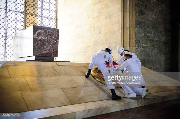 Chief of Naval Operations CNO Admiral Jonathan Greenert ceremoniously places a wreath at the base of Ataturk's sarcophagus with Turkish navy honor...