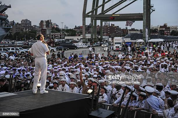 Chief of Naval Operations CNO Admiral Jonathan Greenert helps start the USO New York City Fleet Week block party by thanking the international...