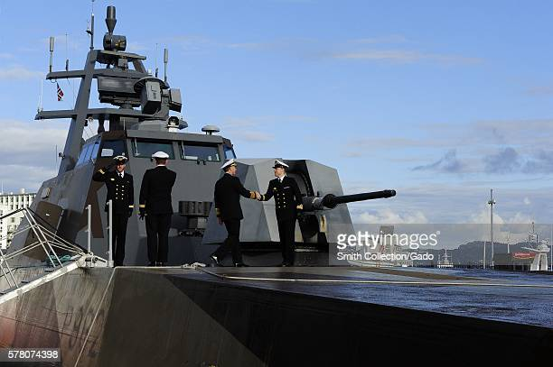 Chief of Naval Operations CNO Admiral Jonathan Greenert is greeted by the commanding officer of the Skjoldclass coastal corvette HNoMS Skudd P962 for...