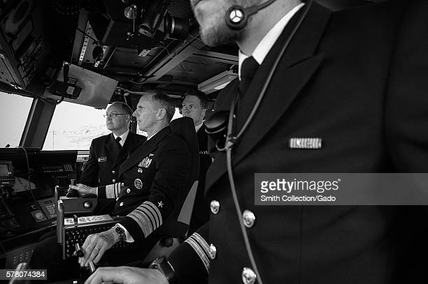 Chief of Naval Operations CNO Admiral Jonathan Greenert pilots the Skjoldclass coastal corvette HNoMS Skudd P962 during a visit with Chief of the...