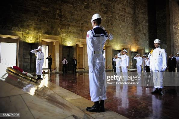 Chief of Naval Operations CNO Admiral Jonathan Greenert salutes a wreath he and Turkish navy honor guard sailors ceremoniously placed in the Hall of...