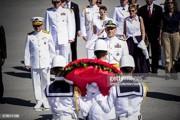 Chief of Naval Operations CNO Admiral Jonathan Greenert salutes Turkish navy honor guard sailors bearing a wreath to be laid at the Anitkabir...