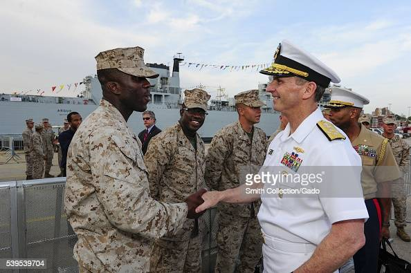 Chief of Naval Operations CNO Admiral Jonathan Greenert shakes hands and meets with Marines at the USO New York City Fleet Week block party New York...