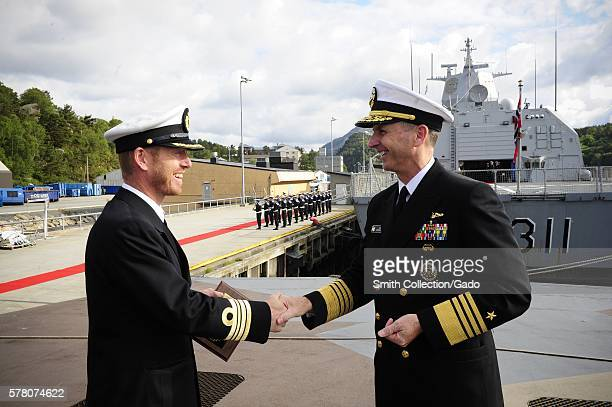 Chief of Naval Operations CNO Admiral Jonathan Greenert shakes hands with a Royal Norwegian navy officer during a tour of the Skjoldclass coastal...