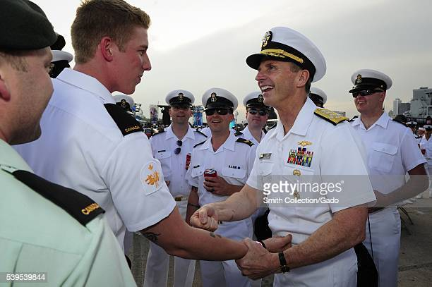 Chief of Naval Operations CNO Admiral Jonathan Greenert shares a laugh with Royal Canadian Navy sailors at the USO New York City Fleet Week block...