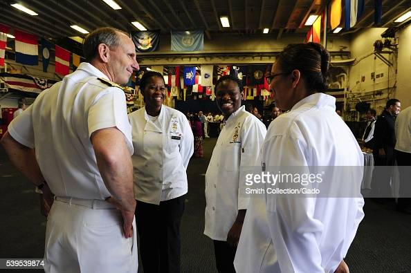 Chief of Naval Operations CNO Admiral Jonathan Greenert talks with Sailors at a UN Community Advisors Reception aboard the amphibious assault ship...