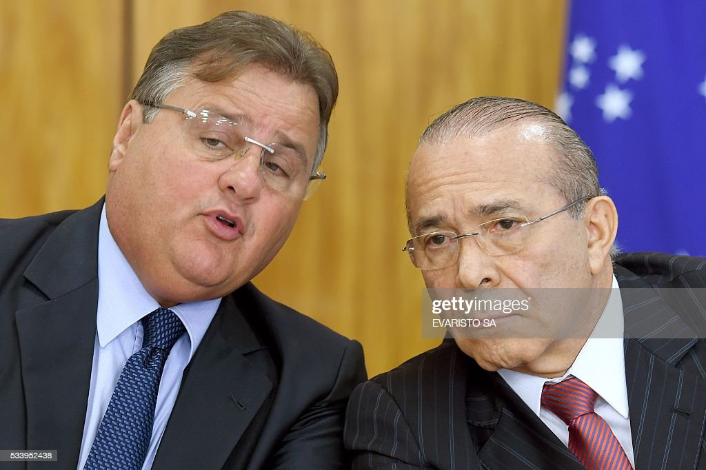 Chief of Staff Eliseu Padilha (R) and Minister of Government Secretariat Geddel Vieira Lima talk during a press conference to explain the government's economic measures aimed at curbing public spending and reviving growth, in the Planalto Palace, the seat of government, in Brasilia on May 24, 2016. / AFP / EVARISTO SA