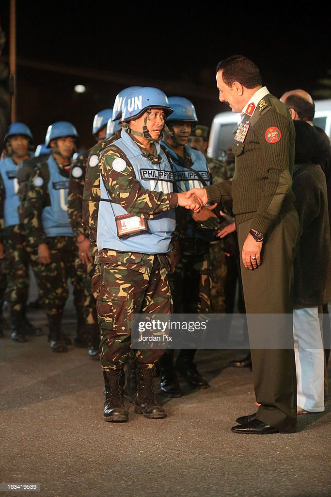 Chief of Staff Mishaal al Zaben greets the Twenty-one Filipino UN peacekeepers who were held hostage at the free Syrian army in Golan as they arrive in Amman after crossing into Jordan from Syria on March 9, 2013 in Amman, Jordan. The hostages were received by the Jordanian Foreign minister Nasser Joudah, Minister of Information Samih Maaytah and the Chief of Staff Mishaal al Zaben.