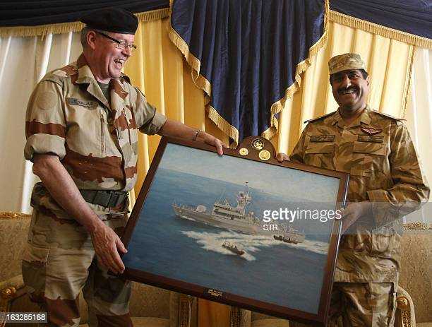 Chief of Staff of Qatar's armed forces Hamad Bin Ali alAttiyah and French army's Chief of Staff Admiral Edouard Guillaud exchange gifts on the final...