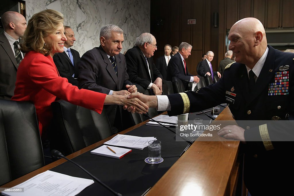 Chief of Staff of the Army Gen. Raymond Odierno (R) greets Senate Armed Services Committee committee member Sen. <a gi-track='captionPersonalityLinkClicked' href=/galleries/search?phrase=Kay+Hagan&family=editorial&specificpeople=5592035 ng-click='$event.stopPropagation()'>Kay Hagan</a> (D-NC) before Odierno and other members of the U.S. military Joint Chiefs of Staff testify on Capitol Hill May 6, 2014 in Washington, DC. Joined by senior enlisted officers, the Joint Chiefs testified about proposals relating to military compensation.