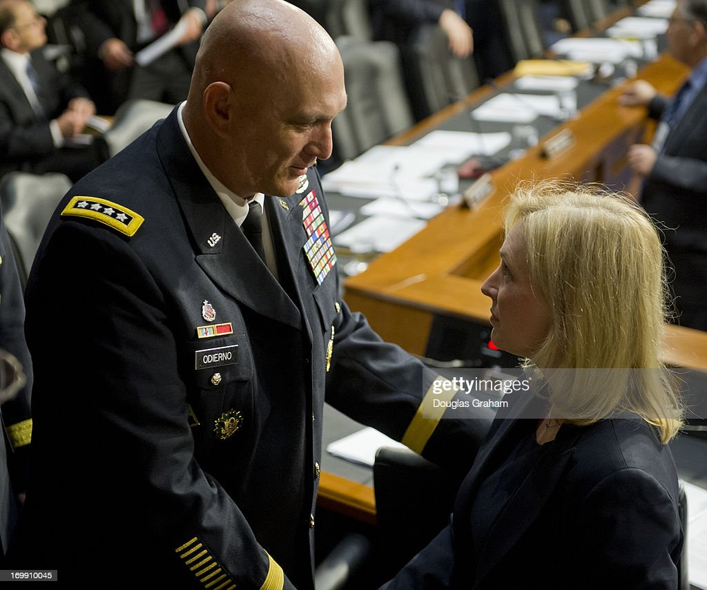 Chief of Staff of the Army General Raymond Odierno talks with Sen. Kirsten Gillibrand, D-NY., talk before the start of the Armed Services Committee hearing on pending legislation regarding sexual assaults in the military in the Senate Hart Office Building on June 4, 2013.
