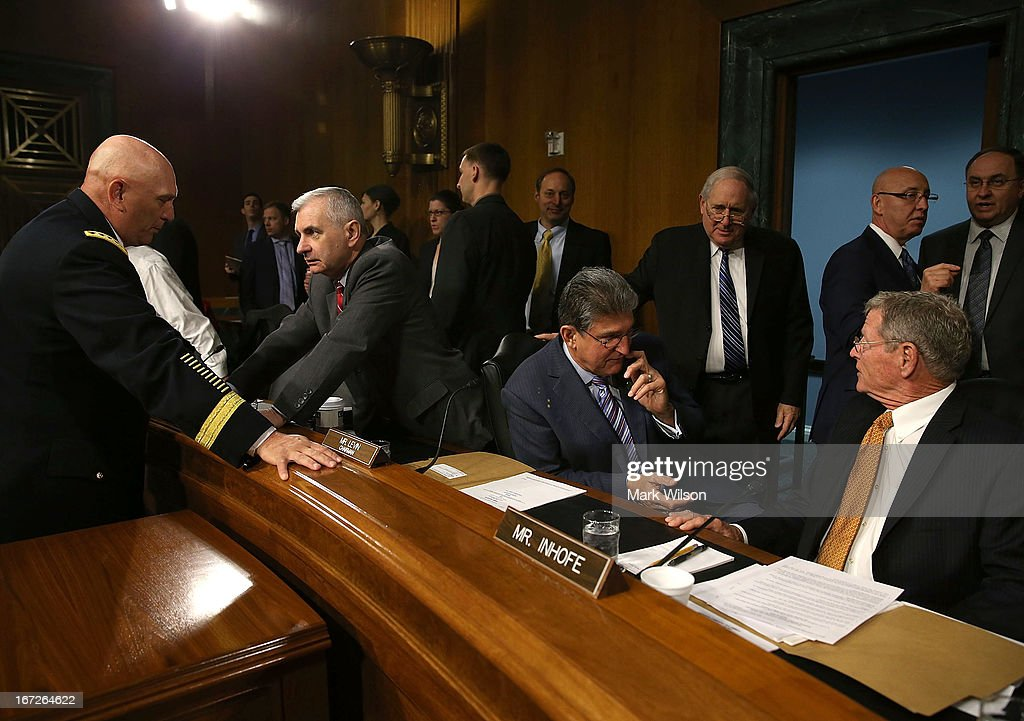 Chief of Staff of the U.S. Army Gen. Raymond Odierno (L), talks with Sen. <a gi-track='captionPersonalityLinkClicked' href=/galleries/search?phrase=Jack+Reed+-+Politician&family=editorial&specificpeople=534274 ng-click='$event.stopPropagation()'>Jack Reed</a> (D-RI) (2nd-L) while Senators <a gi-track='captionPersonalityLinkClicked' href=/galleries/search?phrase=Joe+Manchin&family=editorial&specificpeople=568465 ng-click='$event.stopPropagation()'>Joe Manchin</a> (D-WV)(C), Chairman <a gi-track='captionPersonalityLinkClicked' href=/galleries/search?phrase=Carl+Levin&family=editorial&specificpeople=208878 ng-click='$event.stopPropagation()'>Carl Levin</a> (D-MI) and James Inhofe (R-OK) (R) converse, before the start of a Senate Armed Services Committee hearing, on April 23, 2013 in Washington, DC. The committee is hearing testimony on the Department of the Army budget request for FY2014.