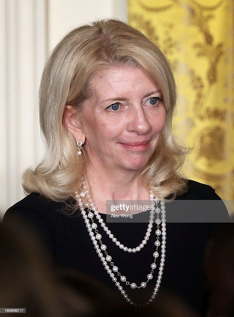 Chief of staff of Vice President Joseph Biden's wife <a gi-track='captionPersonalityLinkClicked' href=/galleries/search?phrase=Jill+Biden&family=editorial&specificpeople=997040 ng-click='$event.stopPropagation()'>Jill Biden</a> Catherine Russell listens to remarks of President Barack Obama during a Women's History Month Reception in the East Room of the White House March 18, 2013 in Washington, DC. President Obama has nominated Russell as the next ambassador-at-large for global women's issues.