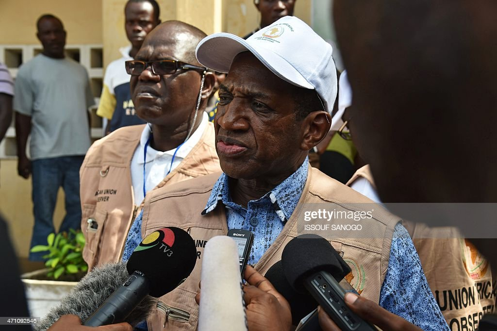Chief of the African Union election observer team Kabine Komara speaks to media ouside the polling station on April 25, 2015 in Lome. Togo votes for a new president with main opposition leader Jean-Pierre Fabre seeking to end nearly 50 years of rule by the Gnassingbe family. AFP PHOTO / ISSOUF SANOGO