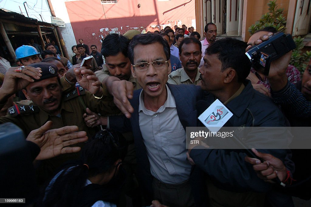 Chief of the banned outfit All Tripura Tiger Force (ATTF), Ranjit Debbarma (C) is produced at the Chief Judicial Magistrate Court in Agartala in the northeastern state of Tripura on January 24, 2013. Ranjit Debbarma, who is wanted by Interpol, was arrested in Bangladesh in December 2012 and 'pushed back' to India through the Meghalaya border, Intelligence officials said according to United News of India (UNI).